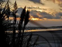 atardecer desde la playa de san luis